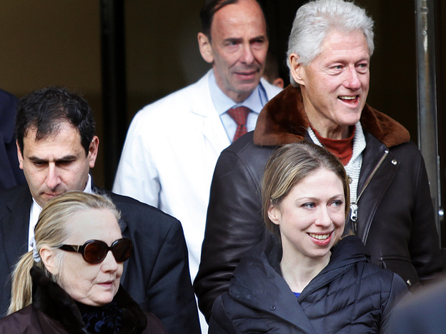 Wednesday: Secretary of State Hillary Clinton (in sunglasses) as she left New York Presbyterian Hospital with her husband, former president Bill Clinton (top right), and their daughter, Chelsea. (Reuters /Landov)