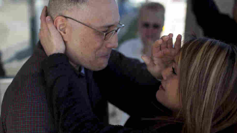 Ernie Lopez hugs his daughter, Nikki Lopez. He was released from prison on March 2, 2012, in Amarillo, Texas, after serving nine years.