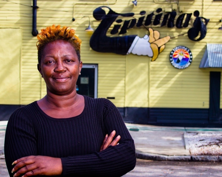 Professor Longhair's daughter Pat Walton Byrd poses outside Tipitina's, a New Orleans venue named after one of her father's compositions. (WWNO)