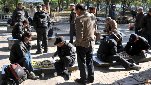 South Korean men play games at a downtown park in Seoul on Nov. 1. Recent data suggest that South Korea is now the fastest-aging country on Earth. (AFP/Getty Images)