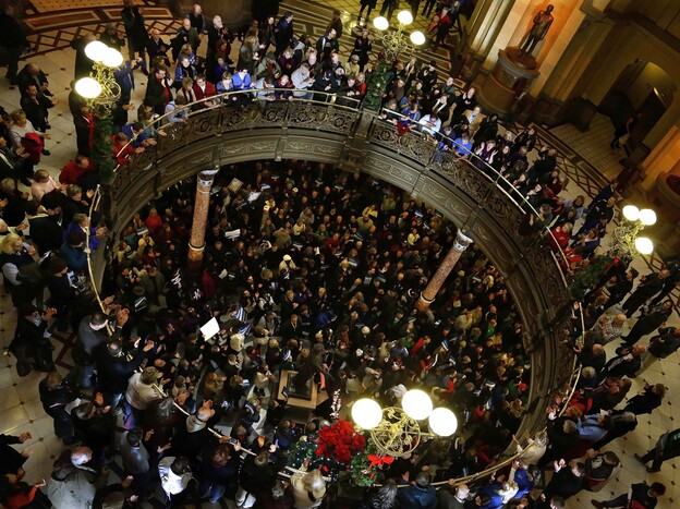 Illinois union members and supporters rally at the state Capitol on Thursday against legislation that would try to control the state's pension-fund shortfall by, in part, reducing pension benefits.