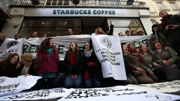 Protesters demonstrate outside a Starbucks coffee shop in London last month. Protests were held at  Starbucks throughout the U.K. after it was revealed that the coffee chain had paid almost no corporate taxes for the last three years.