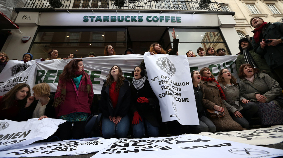 Protesters demonstrate outside a Starbucks coffee shop in London last month. Protests were held at  Starbucks throughout the U.K. after it was revealed that the coffee chain had paid almost no corporate taxes for the last three years. (Getty Images)