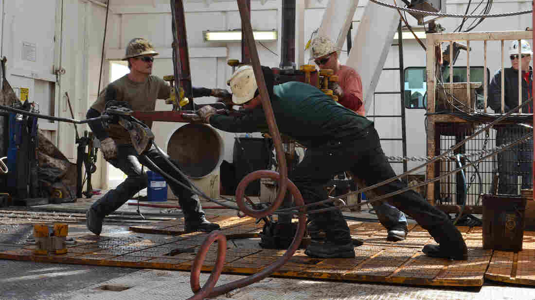 Men hard at work in oil-booming North Dakota.