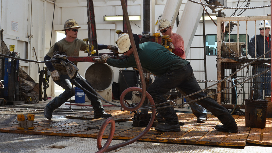 Men hard at work in oil-booming North Dakota. (Todd Melby )