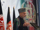 Afghan President Hamid Karzai will meet with President Obama and other senior U.S. officials in Washington this week. Many analysts remain skeptical about the prospects for a negotiated peace in Afghanistan. He's shown here speaking in Kabul last month.