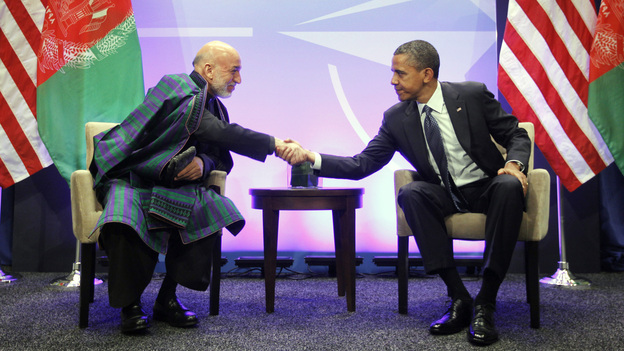 President Obama and Afghan President Hamid Karzai greet each other during a May 20 meeting at the NATO Summit in Chicago. Karzai is in Washington, D.C., this week to meet Obama and other senior U.S. officials. (AP)