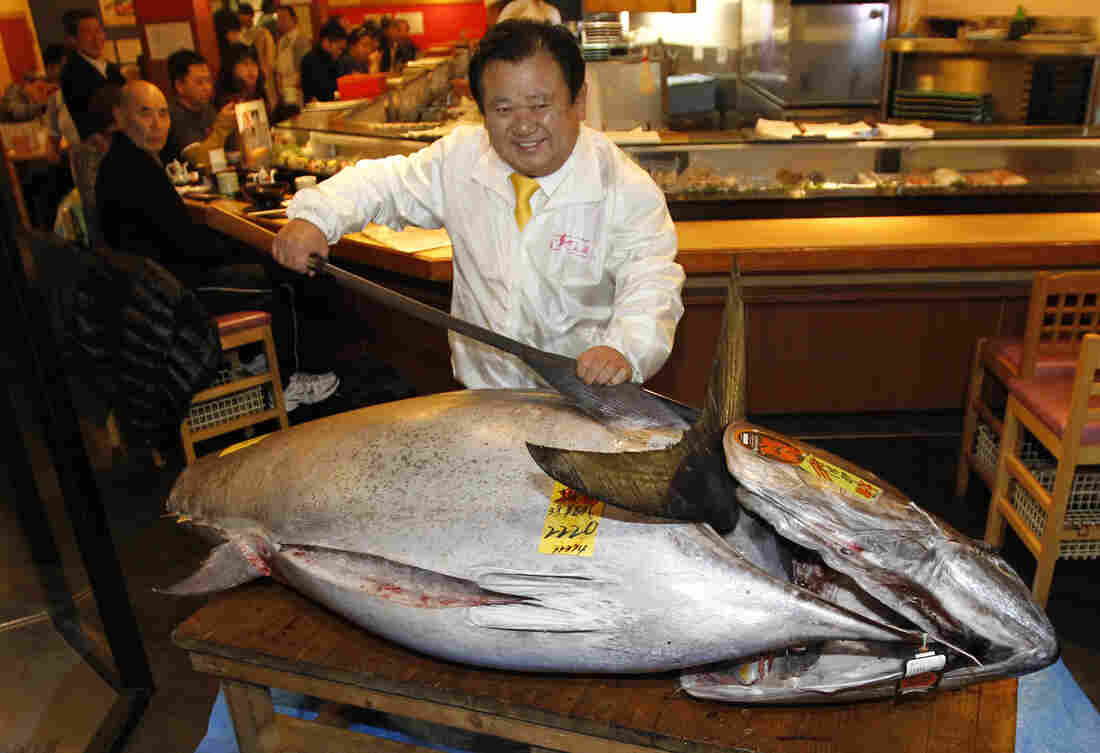 Sushi chain owner Kiyoshi Kimura poses with a bluefin tuna in front of his Sushi Zanmai restaurant in Tokyo on Saturday. He paid more than $1.7 million for the fish.