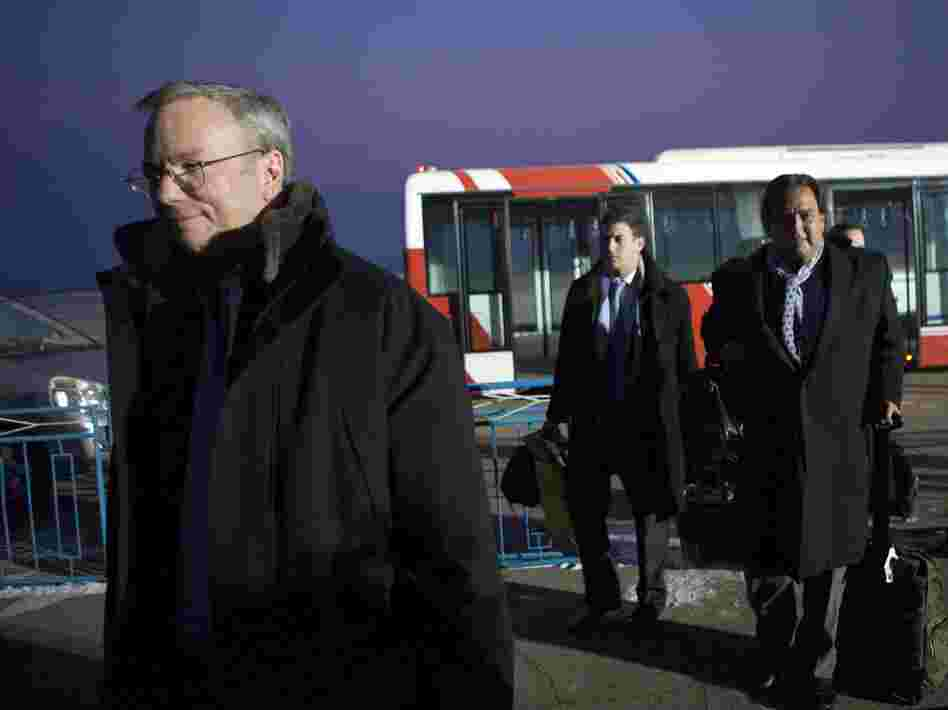 Executive Chairman of Google Eric Schmidt (left) arrives at Pyongyang International Airport on Monday. There is speculation that Schmidt's presence in North Korea could have an upside for Google by positioning him as the company's global ambassador.