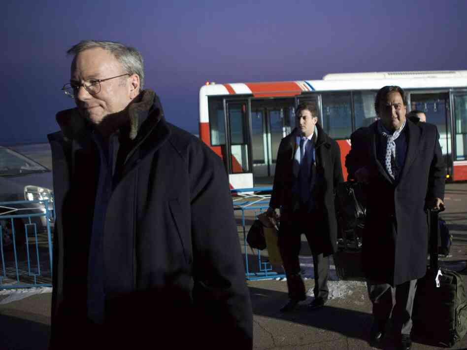 Google's Executive Chairman Eric Schmidt (left) arrives at Pyongyang International Airport on Monday. There is speculation that Schmidt's presence in North Korea could have an upside for Google by positioning Schmidt as the company's global ambassador.