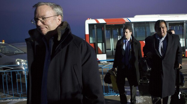 Google's Executive Chairman Eric Schmidt (left) arrives at Pyongyang International Airport on Monday. There is speculation that Schmidt's presence in North Korea could have an upside for Google by positioning Schmidt as the company's global ambassador. (AP)