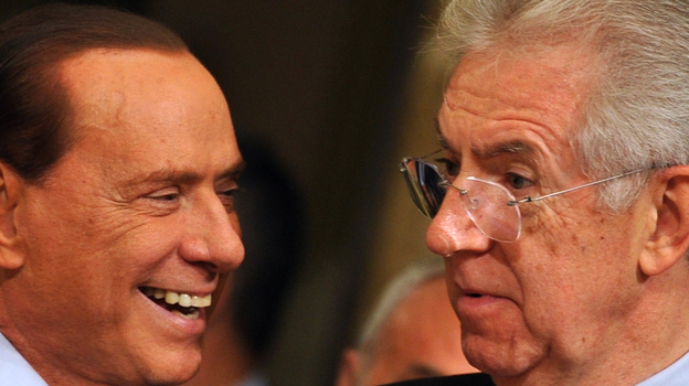 Former Prime Minister Silvio Berlusconi (left) has returned to Italy's political scene in advance of next month's election. Also in the race is the current Prime Minister Mario Monti (right). They are shown here in November 2011 as Monti took over for Berlusconi. (AFP/Getty Images)