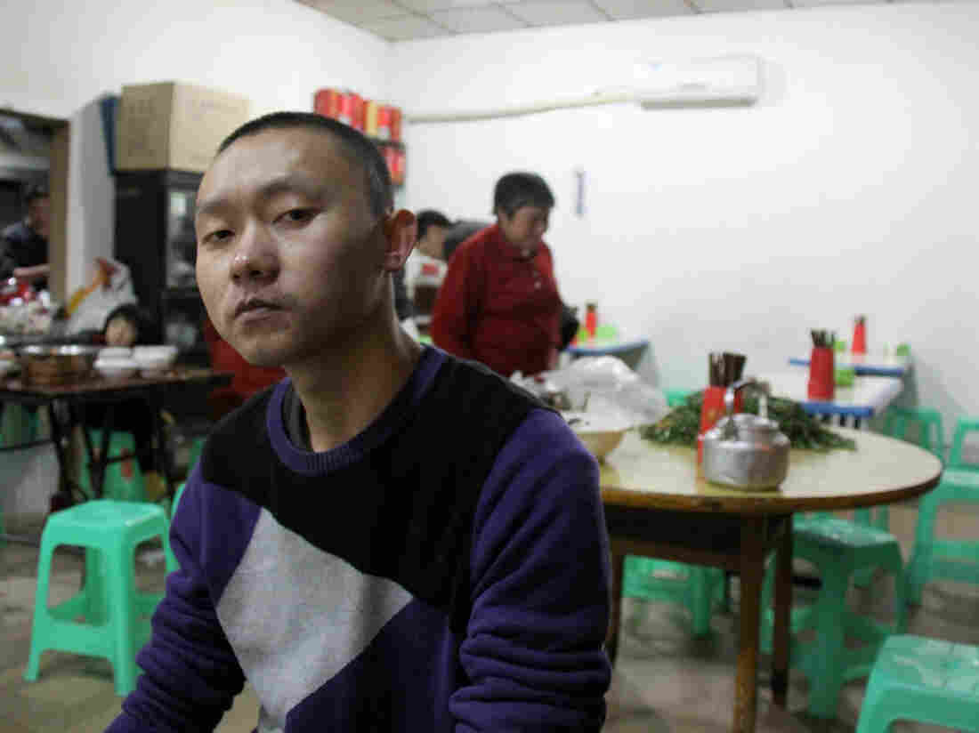 "Ren Jianyu poses for a photograph at a restaurant in Chongqing, China, on Nov. 19, 2012, after being freed from a labor camp. The village official was sentenced to a ""re-education through labor"" camp after he criticized the government."