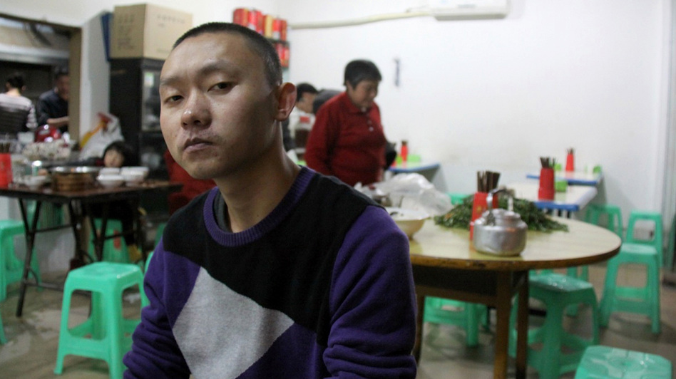 "Ren Jianyu poses for a photograph at a restaurant in Chongqing, China, on Nov. 19, 2012, after being freed from a labor camp. The village official was sentenced to a ""re-education through labor"" camp after he criticized the government. (Reuters/Landov)"