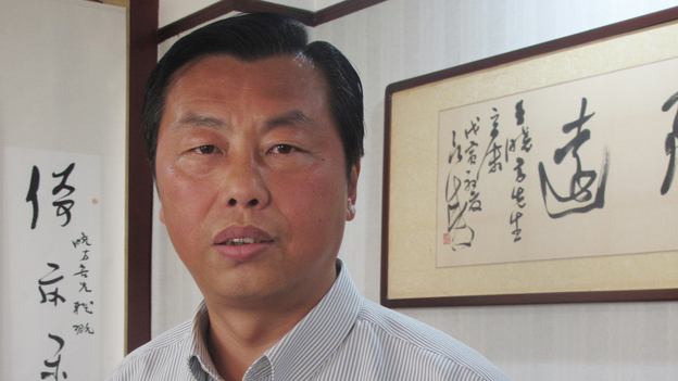 "Former civil servant Wang Xiaofang is the author of 13 books on ""bureaucracy literature,"" including The Civil Servant's Notebook, which recently was translated into English. (NPR)"