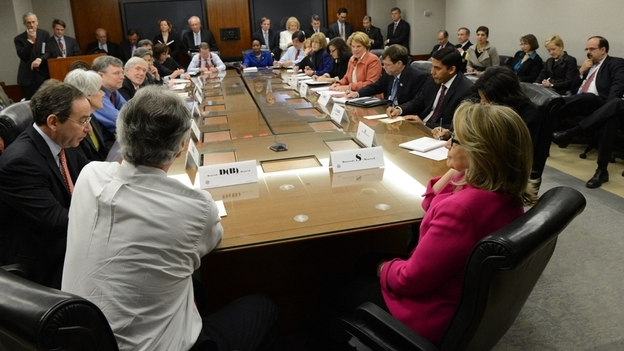 Secretary of State Hillary Clinton (at right, in front) in a photo released today (Jan 7, 2013) by the State Department. A spokesman says it was taken around 9:15 a.m. ET at a meeting with the department's assistant secretaries. (State Department)