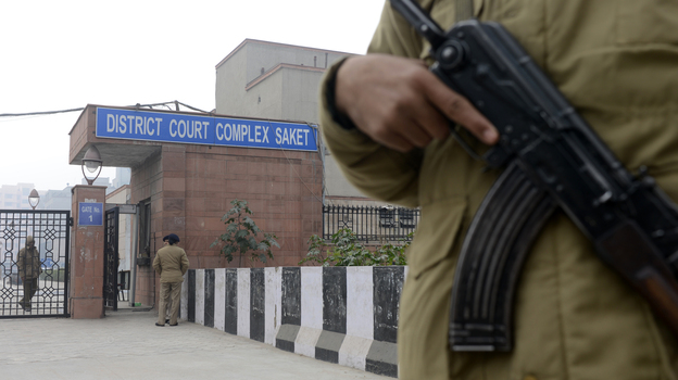 Inside the courthouse in New Delhi today, there were  chaotic scenes leading up to a  hearing for men accused in the rape and death of a young woman. Outside, Indian police stood watch. (AFP/Getty Images)