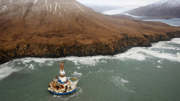 The 266-feet-wide Kulluk oil rig, seen here as it sat aground last Thursday, is being towed 30 miles to the north.