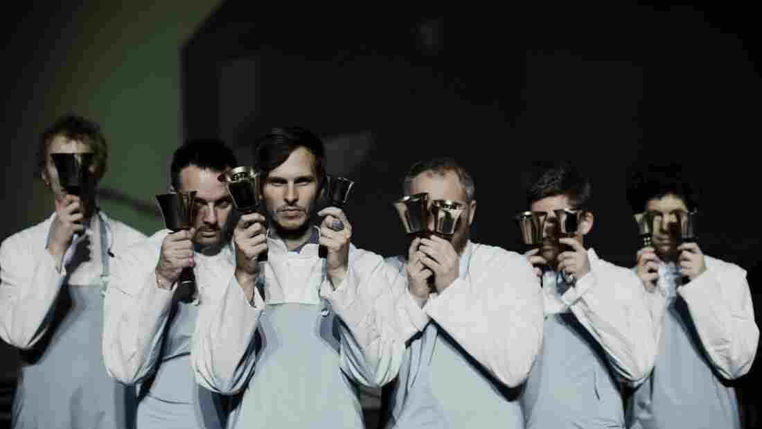 Pantha Du Prince (center), flanked by members of The Bell Laboratory.