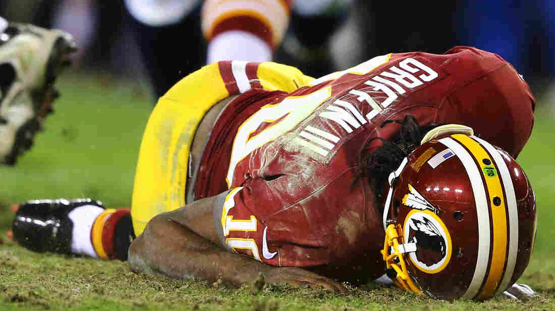 Washington Redskins quarterback Robert Griffin III reinjured his right knee during Sunday's playoff game against the Seattle Seahawks. Washington lost 24-14.