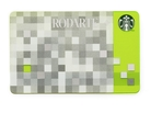This product image released by Starbucks shows the Rodarte design Starbucks gift card, part of a series of limited-edition products for the holiday season. The card is one of several Rodarte-designed items including tote bags, cup sleeves and mugs. The signature pattern features a pixelated checkerboard of gray, white and silver set against different shades of green.
