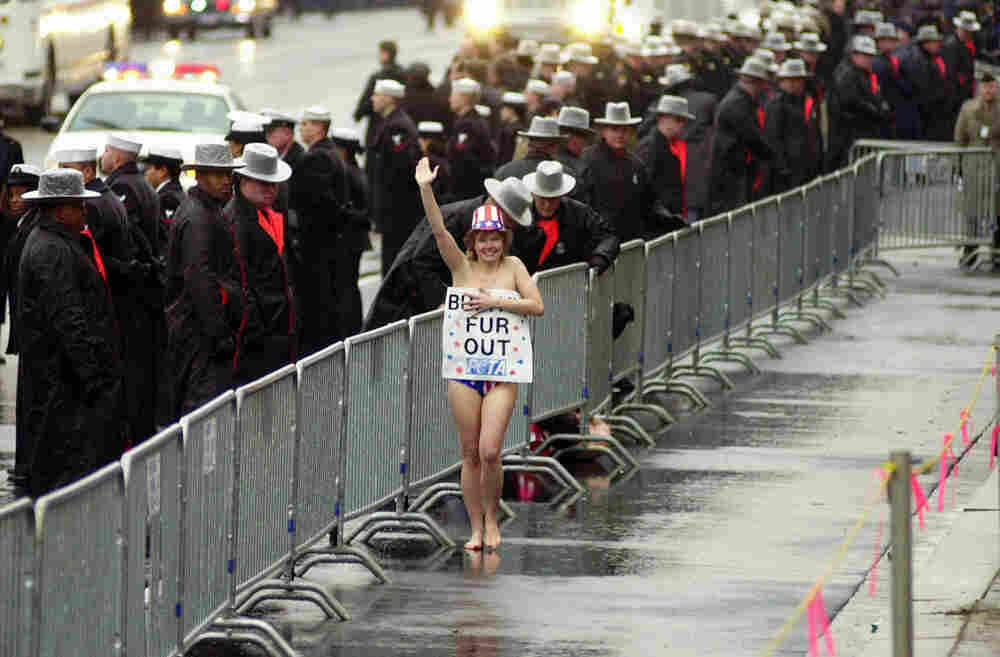 A topless protester braved the Washington, D.C., winter in 2001 during President George W. Bush's inaugural parade.