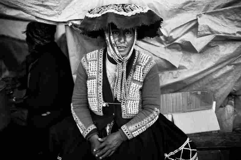 Portrait of a Quechua woman in traditional dress in the Andean town of Ocongate