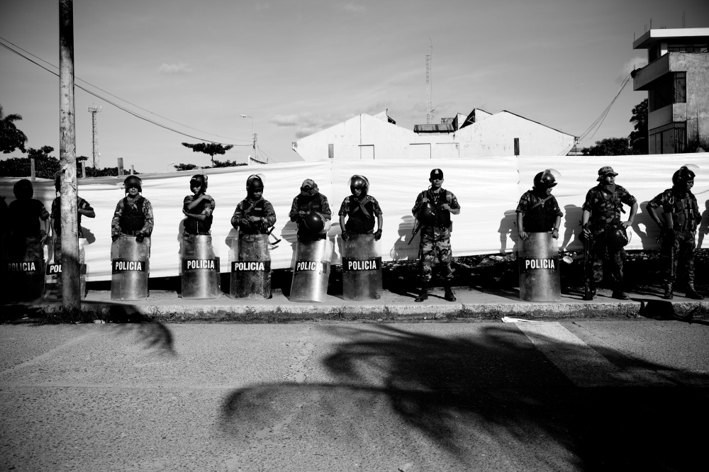 Police line the streets during a miners protest against regulation in April 2010.