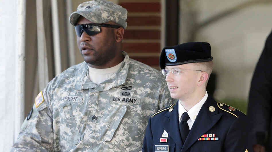 Army Pfc. Bradley Manning is escorted out of a courthouse in Fort Meade, Md., after a pretrial hearing last year.