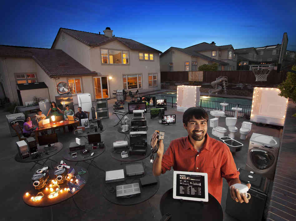 Shwetak Patel (foreground), a MacArthur Fellow, recognized that every device in a home has a unique signature that can be used to track energy usage. The data collected by Patel's system showed that digital video rec