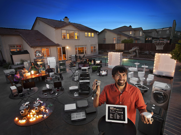 Shwetak Patel (foreground), a MacArthur Fellow, recognized that every device in a home has a unique signature that can be used to track energy usage. The data collected by Patel's system showed that digital video recorders were responsible for 11 percent of this home's power use, just one example of <a href=