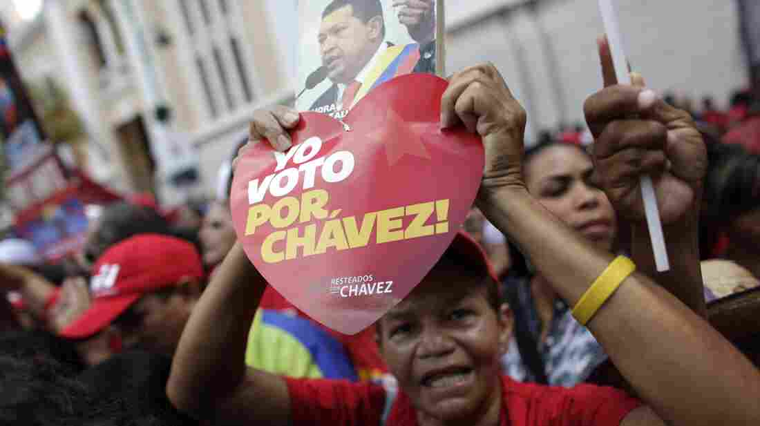 "A supporter of Venezuela's President Hugo Chavez holds a heart-shaped sign that reads in Spanish ""I vote for Chavez!"" and a picture of Chavez outside the National Assembly in Caracas over the weekend. On Thursday, Chavez is scheduled to be sworn in for a fourth term. Government officials are suggesting the ceremony could be delayed as the president recovers from cancer surgery in Cuba."