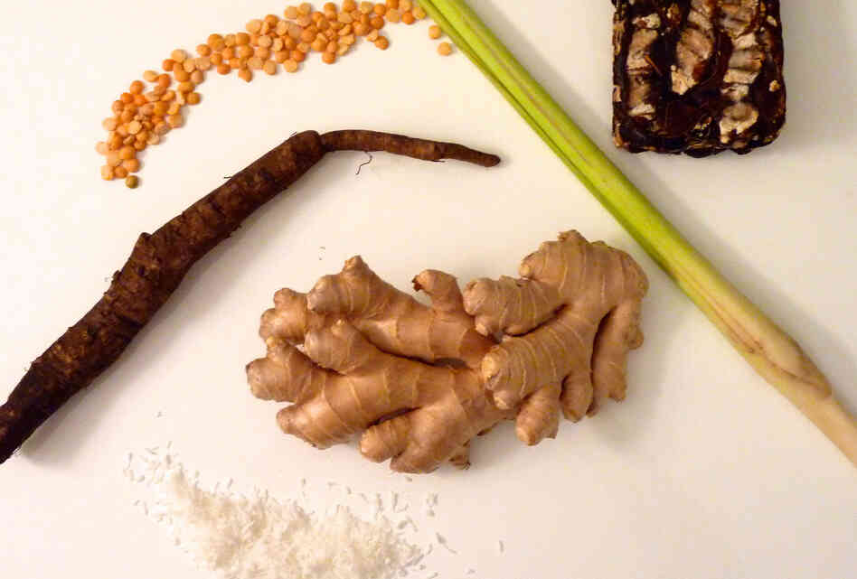 "Ginger, tamarind and coconut are common ingredients in so-called ""detox"" beverages. But food writer Eve Turow prefers them as part of a great meal — in solid form. (Also pictured are yellow split peas, lemongrass and burdock root.)"
