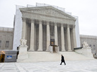 A photographic screen hangs in front of the U.S. Supreme Court, which is undergoing renovations. On Wednesday, the justices will hear arguments in a case that asks whether police without a warrant can administer a blood test to a suspected drunken driver.