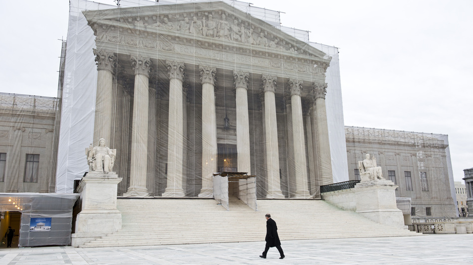 A photographic screen hangs in front of the U.S. Supreme Court, which is undergoing renovations. On Wednesday, the justices will hear arguments in a case that asks whether police without a warrant can administer a blood test to a suspected drunken driver. (MAI/Landov)