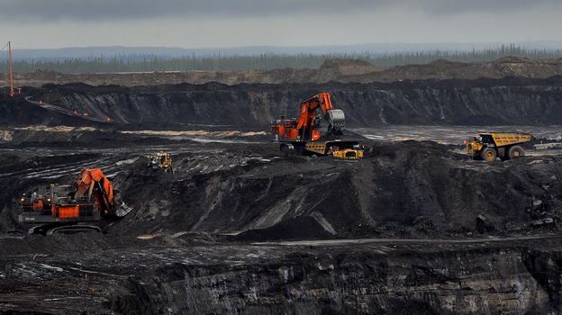 The Shell Oil Jackpine open pit mine uses trucks that are 3 stories tall, weigh 1 million pounds and cost $7 million each. There is explosive growth in the oil field areas around Fort McMurray, Alberta, Canada. (The Washington Post/Getty Images)