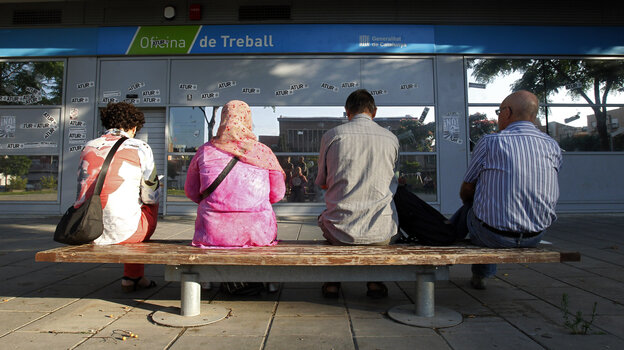 In Badalona, Spain, people waited outside an employment office last summer.