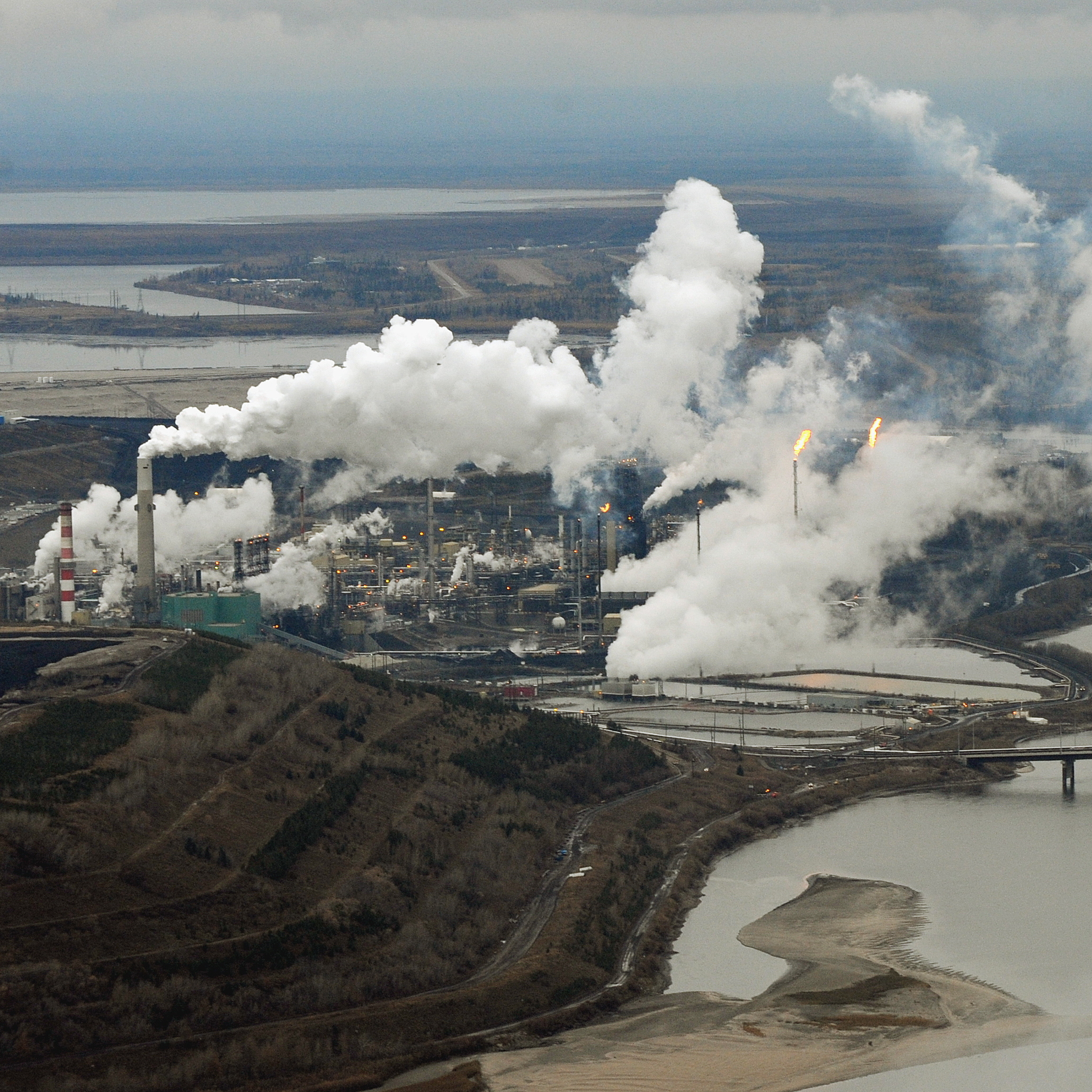 An aerial view of the Suncor oil sands extraction facility on the banks of the Athabasca River in Alberta, Canada, in 2009. Scientists say contaminants found at the bottom of lakes in Alberta are from air pollutants from the facilities responsible for producing and processing tar sands oil.