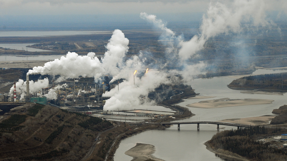 An aerial view of the Suncor oil sands extraction facility on the banks of the Athabasca River in Alberta, Canada, in 2009. Scientists say contaminants found at the bottom of lakes in Alberta are from air pollutants from the facilities responsible for producing and processing tar sands oil. (AFP/Getty Images)