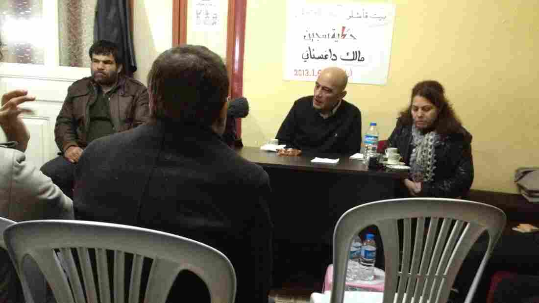 Beit Qamishlo is a modest house in southern Turkey that caters to Syrian exiles seeking temporary refuge. It also hosts frequent discussions on Syria's future. Here, Malik Dagestani (center), a former political prisoner in Syria, talks about his detention in the 1980s and 1990s.