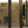 A man enters a UBS bank in Hong Kong last month. The Swiss banking giant agreed in 2009 to identify the names of its U.S. account holders, part of a push by banking regulators to make it harder to hide income.