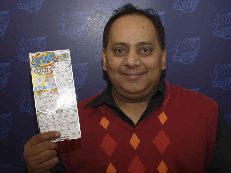 Urooj Khan, with his winning lottery ticket. Not long after this photo