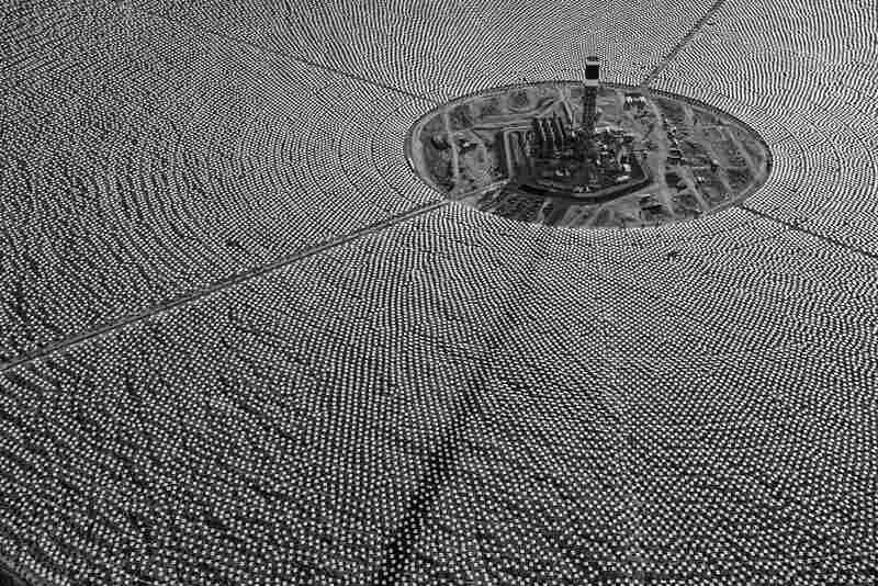Completed tower for Solar Field One surrounded by thousands of heliostats. Eventually, they will send concentrated solar thermal energy to the top of the tower, superheating water to create steam and drive turbines. October 2012.