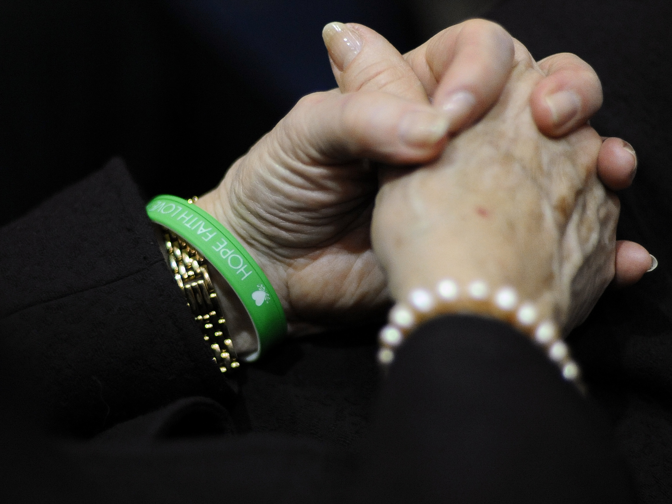 Newtown Schools Superintendent Janet Robinson wears a bracelet reading Hope, Faith, Love in the school colors of Sandy Hook Elementary during Gov. Dannel Malloy's State of the State address at the Capitol in Hartford, Conn., on Wednesday.