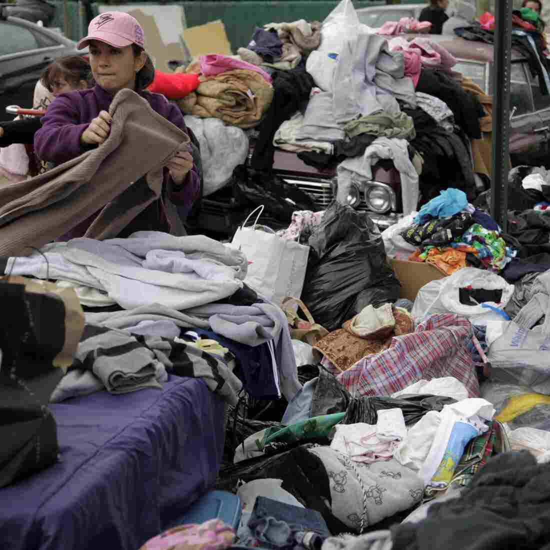 Volunteers sort through piles of donated clothes for Superstorm Sandy victims at an impromptu Staten Island aid station in November. Relief groups are still trying to figure out what to do with donated clothes people sent to New York and New Jersey in Sandy's aftermath.