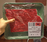 Super-sized steaks for big beef producers. The height of each steak, from top to bottom, is scaled to the state's annual beef production. Iowa made 6.5 billion pounds of beef last year, so its steak is about 6.5 inches tall.