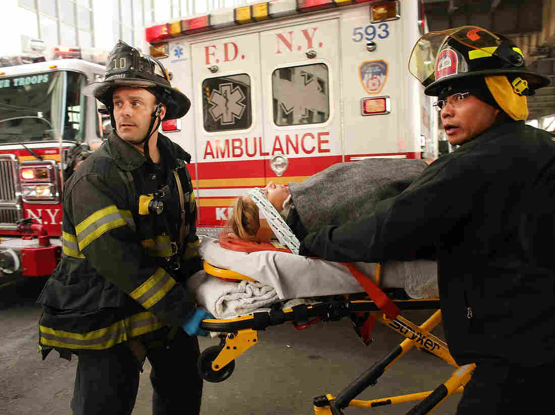 An injured person is moved to an ambulance following a ferry accident during rush hour in Lower Manhattan on Wednesday. At least 50 people were injured, according to news reports. The ferry ran into a pier, causing a large gash on its front side.