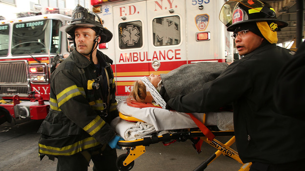 An injured person is moved to an ambulance following a ferry accident during rush hour in Lower Manhattan on Wednesday. At least 50 people were injured, according to news reports. The ferry ran into a pier, causing a large gash on its front side. (Getty Images)
