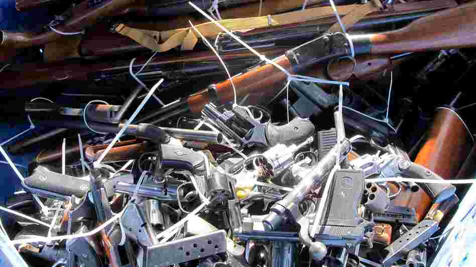 Guns are piled inside a crate outside a police station in Tucson, Ariz., on Tuesday during a buyback. Tuesday marked the second anniversary of when a gunman opened fire on former Rep. Gabrielle Giffords as she met with constituents in 2011, killing six people and leaving 12 others injured.