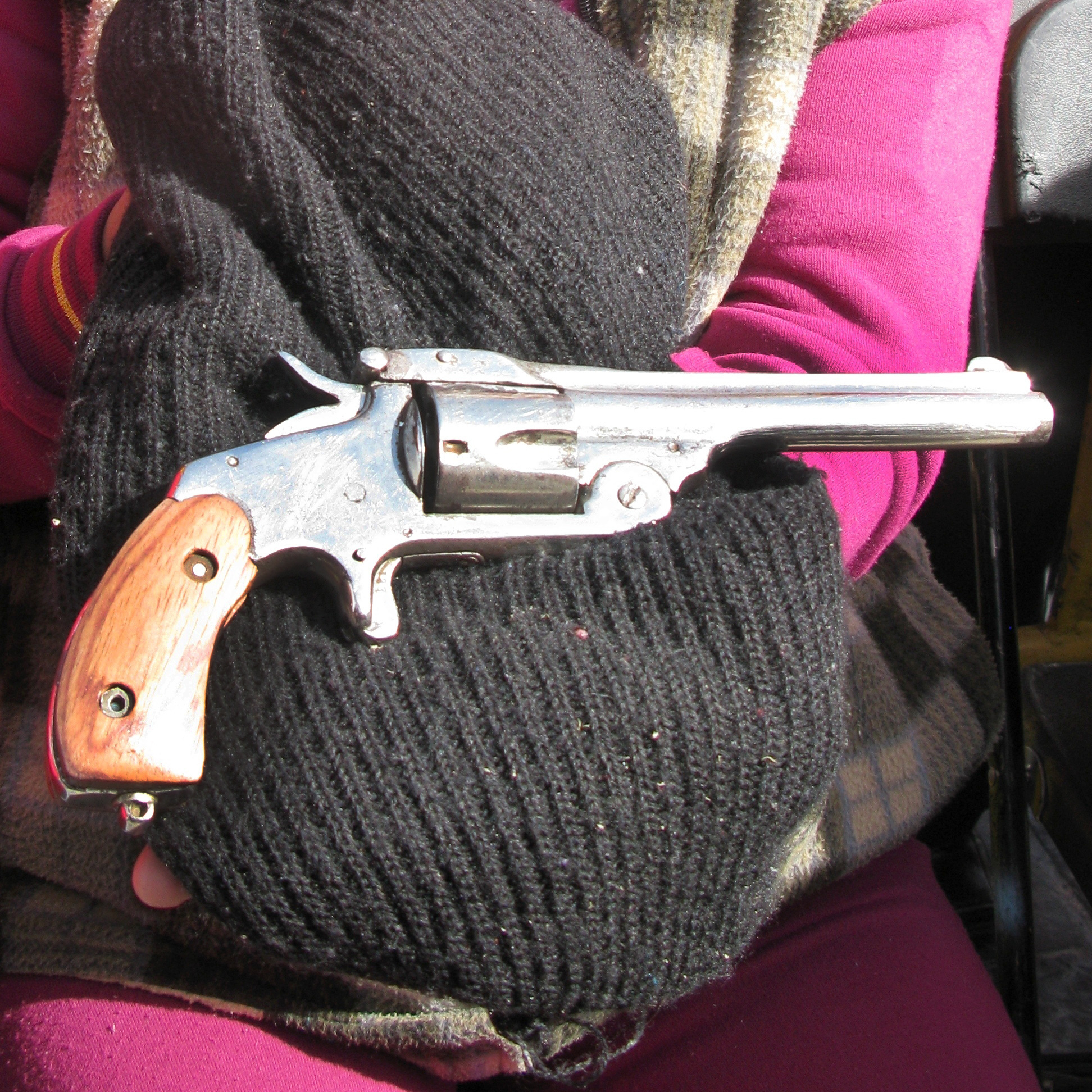 In Mexico City, Sara Martinez Franco holds a .38-caliber revolver that belonged to her grandfather. She traded in the weapon -- which she says was used during the Mexican Revolution -- under the buyback program.